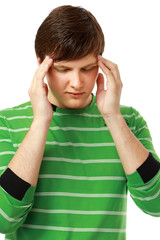 A young man having a headache