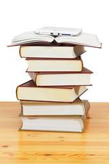 Pile of paper books and e-book