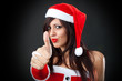 girl wearing santa claus clothes giving an ok sign