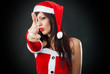 girl wearing santa claus clothes shooting with hand