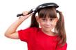 Little girl holding a frying pan
