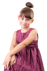 Cute little girl in a burgundy dress