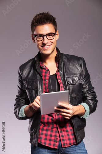 happy young casual man with tablet