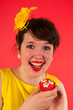 Colorful girl in red and yellow eating cupcake