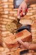 Building a masonry heater - closeup on worker hands