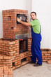 Worker building a masonry heater