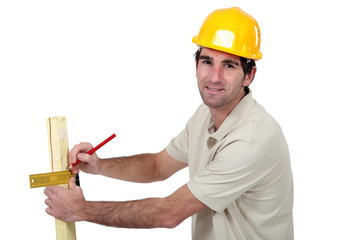 Man marking timber