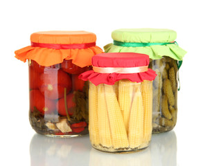 Jars with canned vegetables isolated on white