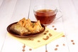 Sweet baklava on plate with tea on wooden background