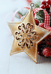 Rustic christmas decoration with golden star