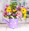beautiful bouquet of bright flowers in watering can