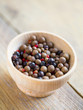 Pimento, juniper berries and pink peppercorns in a bowl