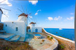 Panoramic view of two windmills and their bases Mykonos Greece C