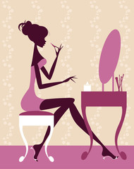 Pretty Female Sitting at Dressing Table Applying Make Up