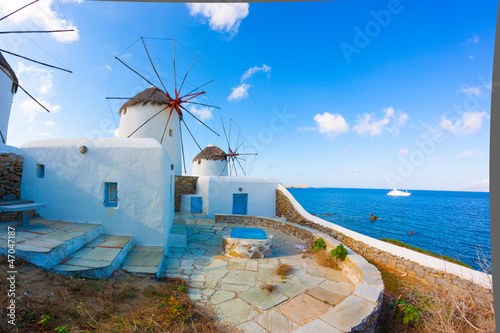 Panoramic view of two windmills and their bases Mykonos Greece C - 47047187