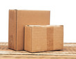 cardboard boxes on a wooden background