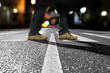 man crossing street at night