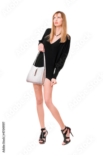 Sensual beautiful girl with the purse