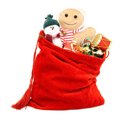 Santa's gift bag full of toys and gifts over white