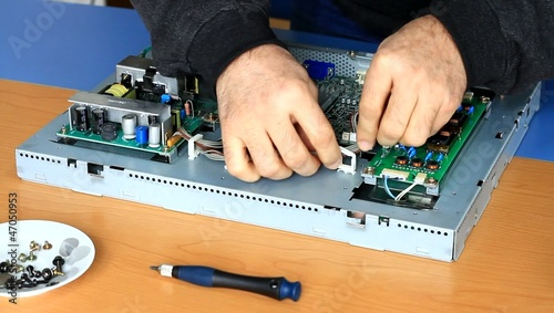 Technician fixing circuit board cables