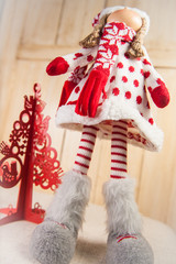 Christmas Doll and a red christmas tree