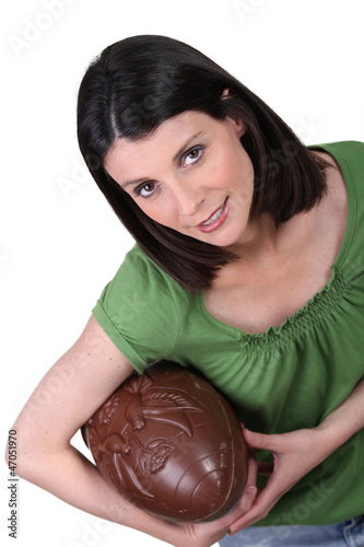 woman holding an enormous chocolate Easter egg