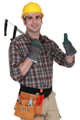 Builder holding calipers and giving the thumbs-up