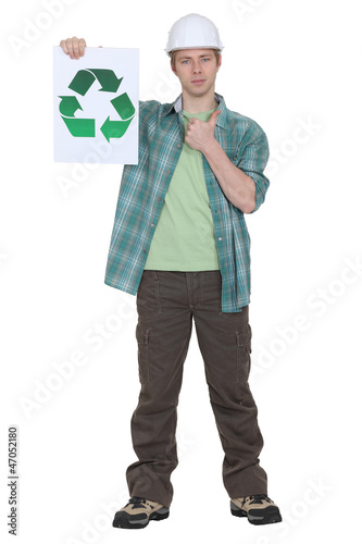 Man holding sign with recycling symbol