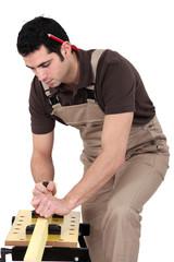 Man planning wood