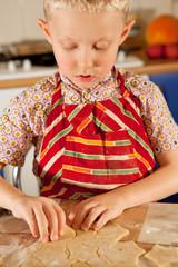 Little boy prepare christmas cookies