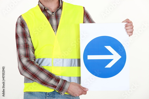 Man holding road sign