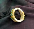Luxury ivory bracelet decorated by gold and turquoise.