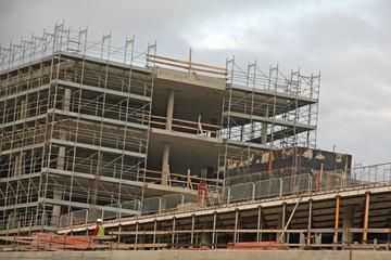 scaffolding n a construction site of a large concrete building