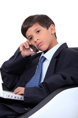 Little boy dressed as businessman