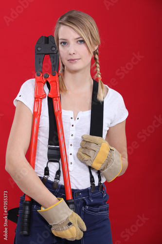 Woman holding bolt-cutters