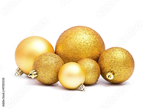 Golden Christmas spheres on the white