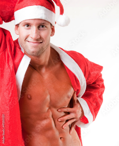 muscular santa claus flexing his muscles