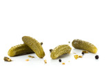 Pickled green gherkins with spices