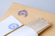 "paper envelope stamped ""Top Secret"""