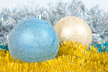 Christmas background with a blue and gold balls