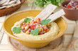 Hummus with a salad of chickpeas and tomatoes with cilantro and
