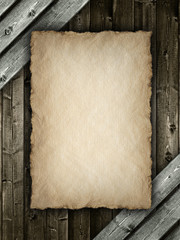 Paper sheet on wood background