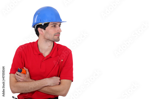 Builder with a tape measure