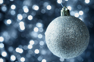 Christmas balls on glittering the background