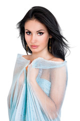 a portrait of a young woman in a blue scarf
