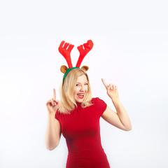 beautiful blonde woman with reindeer antlers is smiling