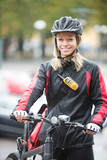 Young Female Cyclist With Courier Delivery Bag