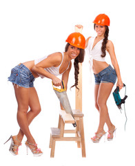 Gemini girls with a saw and a board