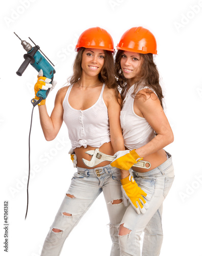 Gemini girls  with an electric drill and a wrench