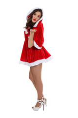 Gorgeous girl in Christmas clothing blowing kisses